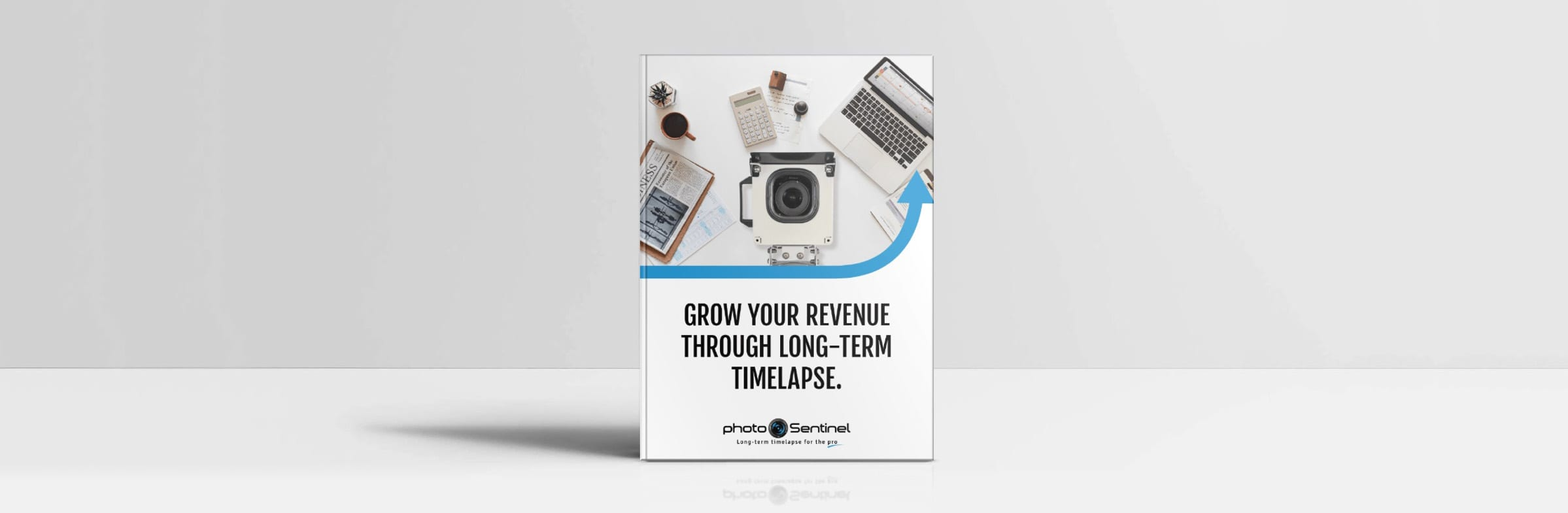 A physical mock-up of the photoSentinel eBook 'Grow Your Revenue Through Long-Term Timelapse'
