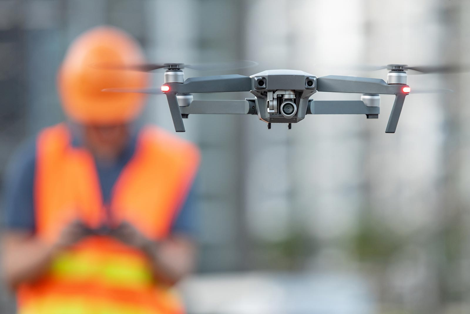 B-roll - A worker controls a drone to take photos of construction site